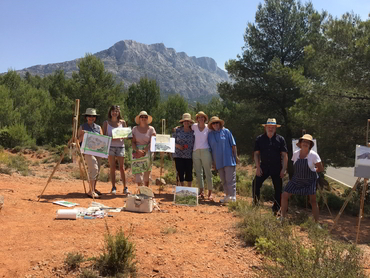 Group of painters in front of the Mont Sainte Victoire during Walk the Arts art workshop in France