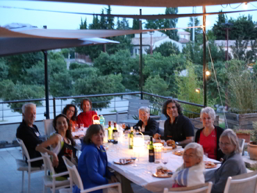 Group having dinner during our painting holidays in France