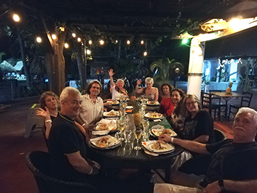 Having dinner together on the Colombian Caribbean Coast during our art workshop in South America