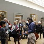 Prof. Yves M. Larocque giving a lecture at the Met during Walk the Arts annual bus tour to New York from Ottawa