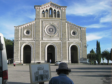 Artist in front of a church in Cortona during Walk the Arts top painting workshop in Italy