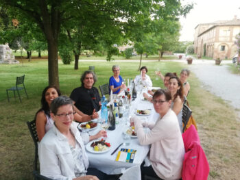 Group having dinner outdoors during Walk the Arts painting retreat in Tuscany Italy